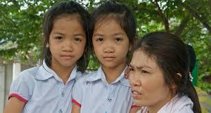 Two Vietnamize children and a Vietnamize woman