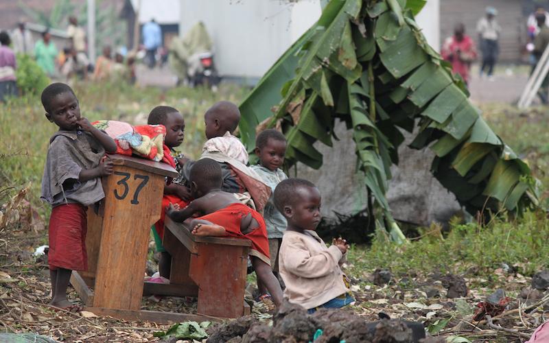 African children sitting on the ground